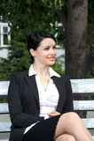 Cute businesswoman sitting on Stock Photo