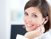Cute businesswoman talking with clients Stock Photos