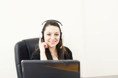 Cute businesswoman talking with clients Royalty Free Stock Photos