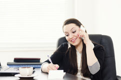Cute businesswoman talking with clients Royalty Free Stock Image