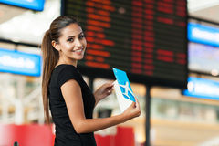 Cute businesswoman travelling. Cute young businesswoman travelling by air Stock Image