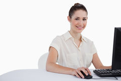 Cute businesswoman using a monitor Royalty Free Stock Photos