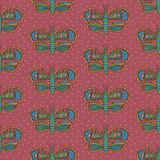 Cute butterfly with colorful desaturated ornament seamless pattern on a pink background Royalty Free Stock Images