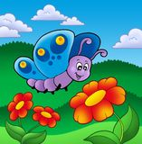 Cute butterfly near red flowers Stock Photography