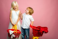 Cute buyer customer client hold shopping cart. Buy with discount. Girl and boy children shopping. Couple kids hold. Plastic shopping basket toy. Kids store royalty free stock images