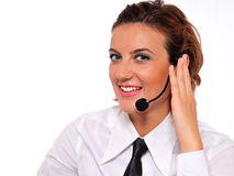 Cute Call Representative. A pretty female call representative wearing a white collared shirt and a black tie, and smiling Stock Photos
