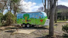 Cute Camper Trailer Hand Painted Cartoon Characters. Camper Trailer with cute cartoon characters royalty free stock images