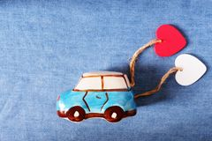 A cute car model tugging hearts, delivering love. Happy Valentine& x27;s day concept. Copy space. A cute car model tugging hearts, delivering love. Happy stock images