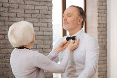 Cute careful aging dance couple performing in the dance studio. Caring about my love . Helpful positive charming women caring about her husband while taking part stock image