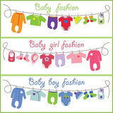 Cute cartoon baby set. Baby fashion. Childrens clothing for newborn baby hanging on the rope. Slip,body,jacket,sliders,hats,socks,a bib for girls,boys and unisex Royalty Free Stock Images