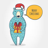 Cute cartoon bear with gift box. New year or Christmas greeting Stock Photos