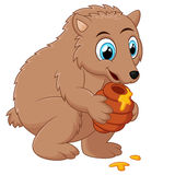Cute cartoon bear holding honey pot Stock Photos