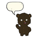 Cute cartoon black bear with speech bubble Stock Images