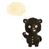 Cute cartoon black bear with thought bubble Royalty Free Stock Images