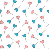 Cute cartoon blue and pink heart lollipop seamless pattern background illustration Stock Photography