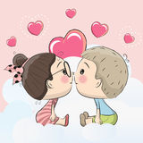 Cute Cartoon boy and girl are kissing. On a cloud royalty free illustration