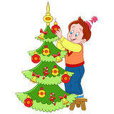 Cute cartoon boy and xmas tree. Cute and happy cartoon boy is decorating xmas tree Royalty Free Stock Images