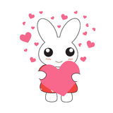 Cute cartoon bunny girl in a pretty pink dress with hearts. Stock Photo