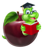 Cute Cartoon Caterpillar Worm. A happy cute cartoon caterpillar bookworm worm or caterpillar reading a book and coming out of an apple and wearing glasses and Royalty Free Stock Images