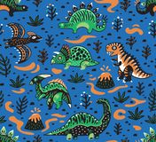 Cute cartoon dinosaurs seamless pattern in red, green and blue colors. Vector illustration Royalty Free Stock Image