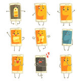 Cute cartoon emoticon phones with funny faces set. Smartphones with different emoticons characters. Isolated on white background Royalty Free Stock Photo