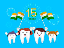 Cute cartoon family tooth character waving India flag. Stock Photo