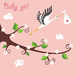 Cute cartoon flowering branch.Flying stork with newborn baby-gir. Cute cartoon baby composition.Flowering branches of a tree. Against the sky flying stork with Royalty Free Stock Image