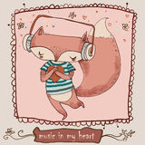Cute cartoon fox enjoys the music with headphones Royalty Free Stock Photography