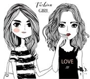 Cute cartoon girls. Cute fashion cartoon girls in sketchy style Royalty Free Stock Images