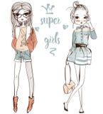 Cute cartoon girls. Cute fashion cartoon girls in sketchy style Stock Photos
