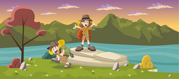 Cute cartoon kids in explorer outfit on a green park Royalty Free Stock Photography