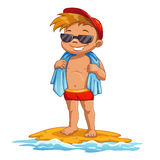 Cute cartoon little boy on the beach. Sunbathes in the sun Royalty Free Stock Image
