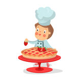 Cute cartoon little boy chef character baking strawberry cake  Illustration Royalty Free Stock Photos