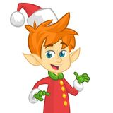 Cute cartoon little boy Santa helper elf stand on white background isolated. Christmas chracter presenting. Cute cartoon little boy Santa helper elf stand on Stock Photography