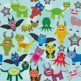 Cute cartoon Monsters seamless pattern on blue background. Vector Stock Photos