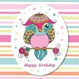 Cute cartoon owl sitting on tree branch Royalty Free Stock Photography