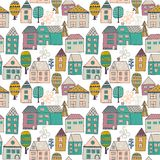 Cute cartoon pattern with tiny houses and trees. Hand drawn seamless ornament with hand drawn town.  Royalty Free Stock Photo