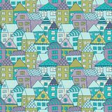 Cute cartoon pattern with tiny houses and trees. Hand drawn seamless ornament with hand drawn town.  Royalty Free Stock Image