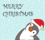 Cute cartoon of a penguin in Santa cap saying Merry Christmas on blue  Stock Photo