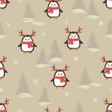 Cute cartoon penguins with deer horns seamless pattern. Vector winter Christmas background Stock Images