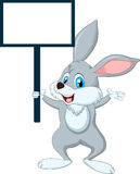 Cute cartoon rabbit with blank sign Stock Photography