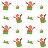 Cute cartoon reindeer cupcake with santa claus hat seamless pattern background illustration Royalty Free Stock Images