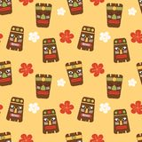 Cute cartoon seamless vector pattern background illustration with tiki tribal mask and hibiscus flowers. Cute cartoon seamless pattern background illustration Stock Photo