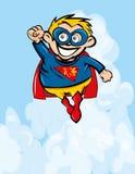 Cute cartoon Superboy flying up. Blue sky behind Royalty Free Stock Image