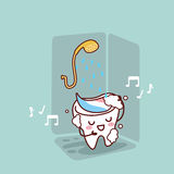 Cute cartoon tooth taking shower Royalty Free Stock Image
