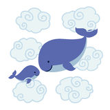 Cute cartoon whales - mother and baby in clouds. Royalty Free Stock Photos