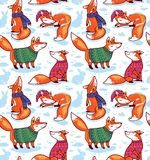 Seamless pattern with cute foxes in sweaters. Holiday vector illustration. Cute cartoon winter foxes in sweaters with ornament. Seamless pattern in comic style Royalty Free Stock Photo