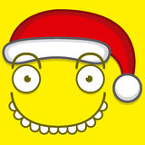 Cute Cartoon Yellow Face With Santa Claus Hat Stock Photography