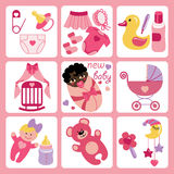 Cute cartoons icons for mulatto newborn baby girl. A set of cute cartoon elements for mulatto newborn baby girl. Baby cartoon icons,scrapbooking elements in Royalty Free Stock Image