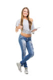 Cute casual teenage girl with digital tablet gesturing thumbs up Stock Photo